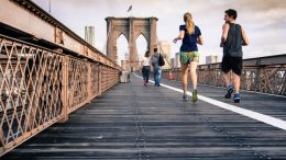 people jogging on bridge